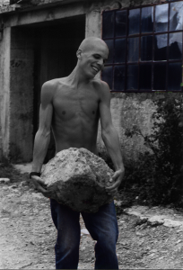 17 years old, carrying a big boulder